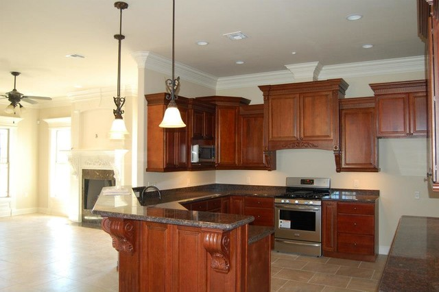 Travis Buquet Home Builders-Houma traditional-kitchen-island-lighting