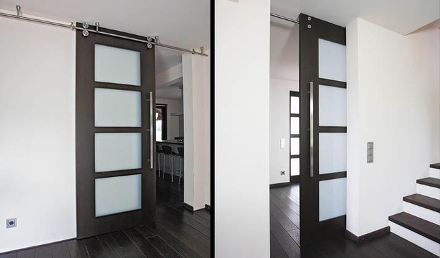 Floor-to-ceiling sliding door with twin-system barn door hardware ...