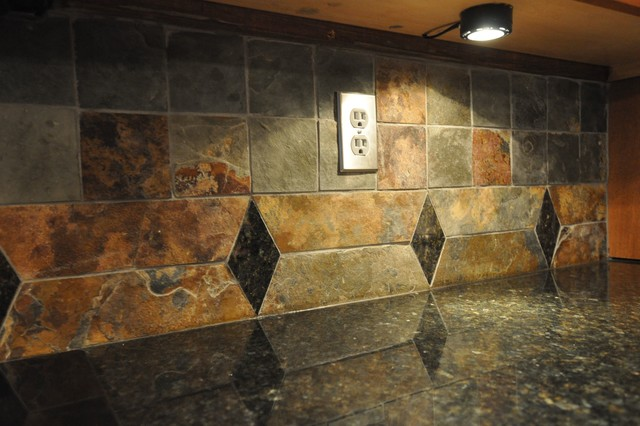 uba tuba granite countertop and tile backsplash eclectic