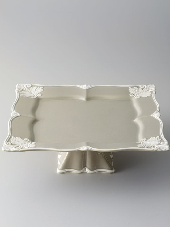 """Horchow - Square """"Baroque"""" Footed Cake Stand - TAUPE - Square """"Baroque"""" Footed Cake StandDetailsElevate sweets and savories to new heights with this elegant footed cake stand featuring a unique square shape and an ornate Baroque design rendered in ivory against a taupe background.Handcrafted of earthenware.Hand painted.Dishwasher and microwave safe.Approximately 13.75""""Sq. x 4.5""""T.Made in Portugal."""