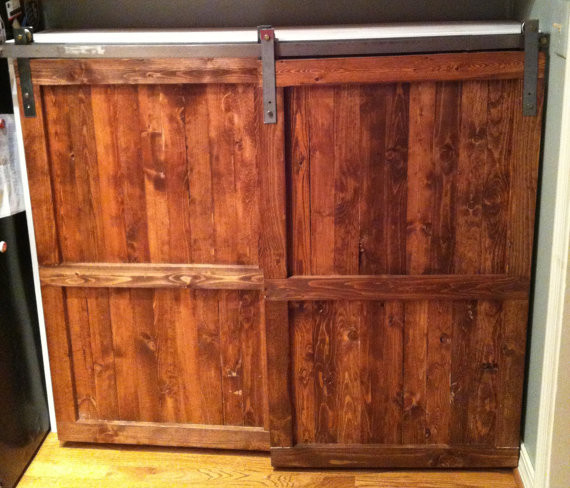 Barn door distressed wood cabinet by the yellow peony for Barn style kitchen cabinets