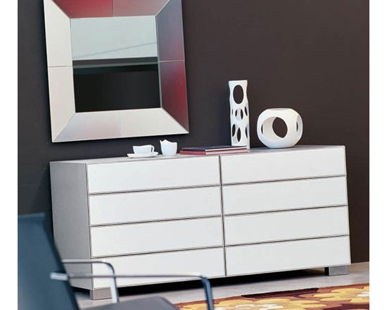 Cattelan Italia - Cattelan Italia | Dandy Dresser - Made in Italy by Cattelan Italia.Bringing the perfect blend of practicality and beauty, the Dandy Dresser is sure to be an inspiring addition to your home. Featuring a leather upholstered front with a wooden frame, this classic dresser combines hard and soft elements for an extremely unique piece. Its stainless steel feet ground the best of natural textures and sophistication of geometric shapes. Select from a variety of wood and leather combination to customize this piece to your exact specifications. Four or Eight spacious drawers store all your clothing and accessories in style with the Dandy Dresser.