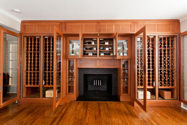 Framed out fireplace w wine cellar