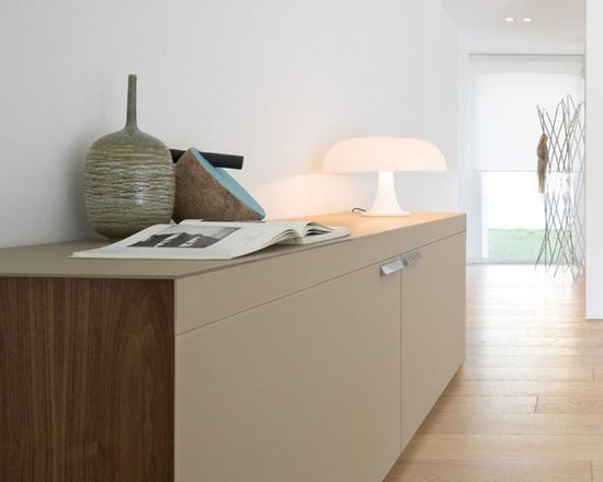 Julie Sideboard - Sideboard with doors opening by coplanar-system.Wooden or lacquered wood frame. Top in extralight tempered painted glass.Painted extralight glass, wooden or lacquered wood doors.Clear tempered glass inside shelves.