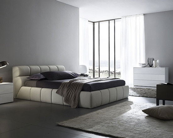 Cloud Bed By Rossetto - Bliss out in the sky with the Cloud Bed. It features supple eco leather,quilted over the entire headboard and platform bed structure in pillow like sections. Simple yet effective,this bed will create a dream in any bedroom.