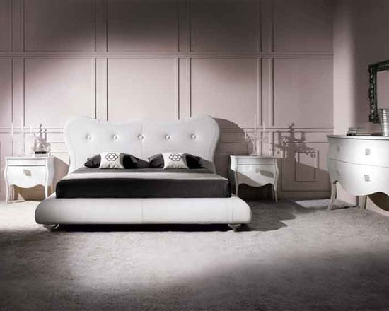 Victoria Italian Leather Bed by Doimo - Inspired by antique Baroque furnishings,the Victoria Italian Leather Bed features a rounded leather headboard with padded button detailing. Feminine and sensuous,it turns any bedroom into a nostalgic scene.