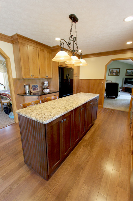 maple kitchen with granite countertop transitional
