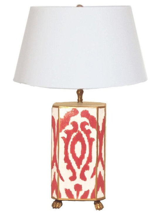 Madagascar Lamp - We love how this cool lamp juxtaposes the rich color combo of coral and white with a modern ikat print motif. Place this hand painted tole lamp, available with a white or black shade, on a mirrored side table or fabulous credenza.