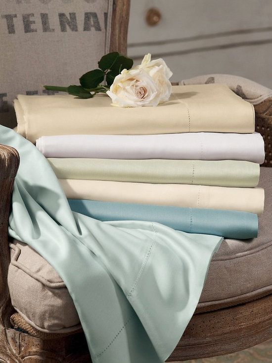 """Blissful Bamboo Sheet Set - Deluxe resort-style sheets of rayon made from bamboo offer dreamy silk-like softness as well as outstanding moisture-wicking properties. These beautiful, breathable sheets adapt to your body temperature so you stay warm in winter, cool in summer for comfy sleep year-round. Flat sheet and pillowcase have generous 4"""" hems and pretty petite hemstitch detail. Eco-friendly. Set includes: 1 flat sheet, 1 fitted sheet, 2 standard pillowcases. King has king pillowcases."""