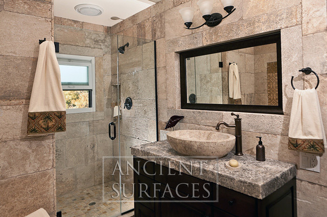 Antique Bathrooms Limestone Shower Walls and Floors mediterranean-tile