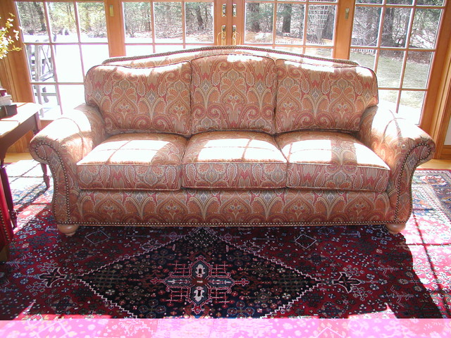 upholstered couch in colorful paisley print finished