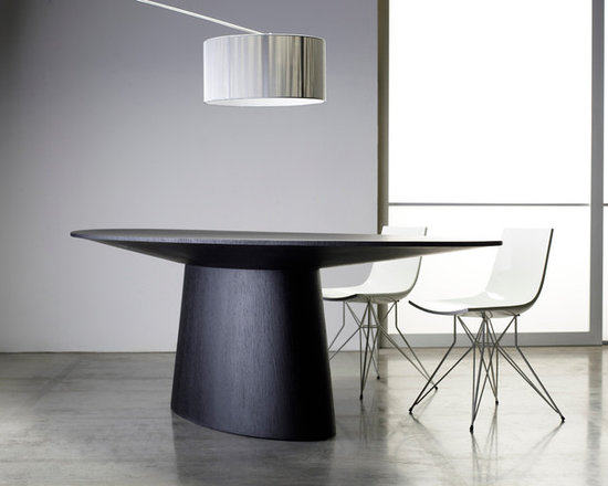 Sullivan Contemporary Dining Table by ModLoft - The Sullivan dining table is a beautiful work of art that embodies innovation and simplicity. This oval table is designed for modern, elegant dining rooms. A reverse-pyramid table top on a tapering base measuring 87L x 44W x 30H for a grand appearance, comfortably seating up to 8 guests. Available in either wenge or walnut wood finishes. Light assembly required. Imported.