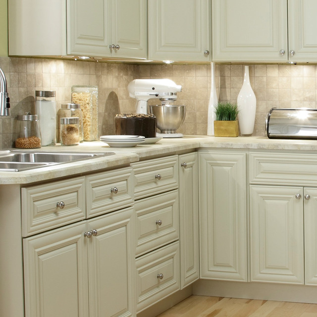 Ivory kitchen cabinets for Cabinets to go