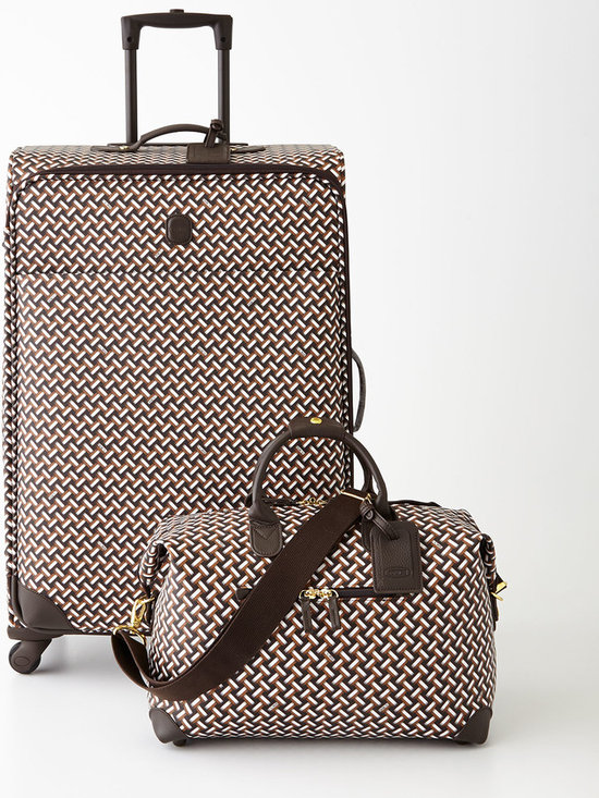 """Bric's - Lattice 20""""T Trolley - Bric'sLattice 20""""T TrolleyDesigner About Bric's:Bric's began when Mario Briccola founded the company in 1952 in the Como region of Italy where it has become internationally renowned for luggage crafted by hand using the finest Tuscan leather and state-of-the-art nylon. Although the company has far outgrown Mario's original workshop the personal touch continues today with a second generation of the Briccola family ensuring its heritage of quality style and attention to detail."""