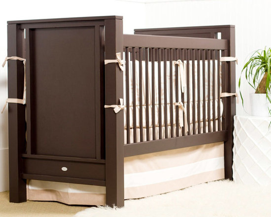 """Newport Cottages - Newport Cottages Ricki Crib - Newport Cottages creates relaxing and happy nurseries and bedrooms with sophisticated, bench made furniture. Simple and elegant, the Ricki crib fuses traditional craftsmanship with a contemporary look. This versatile wood infant bed features dual level fixed gates to keep baby visible at all times, as well as an optional under-crib storage drawer for housing care essentials. The furnishing is available in several finishes and accent colors with an optional toddler guardrail kit. Variance in color or texture is possible due to inherent qualities of handcrafted, hardwood furniture. Made in the USA and completed with non-toxic, low VOC finishes. Available with a standard or distressed finish. Distressing on stained finishes not recommended. 32""""W x 57""""D x 54""""H. Some assembly required. Mattress heights: 22"""", 18"""" and 14"""". Crib mattress not included*To further customize with additional finish and hardware options, please email shop@laylagrayce.com or call (877) 907-1322 for further details."""