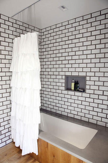 Dark grout bathroom (via Design*Sponge sneak peek: nina gotlieb) modern 