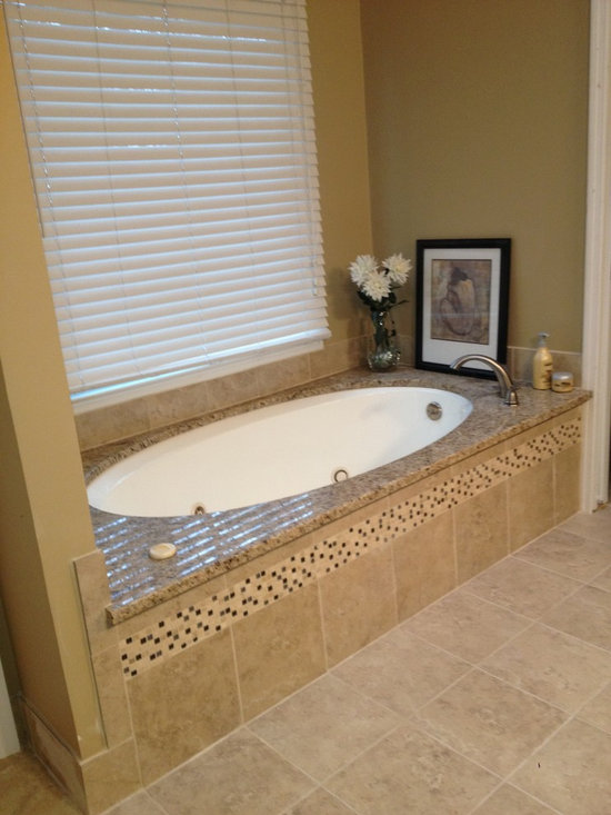 Bathroom remodel - Amanda - Matching granite was installed over the existing tub.  The white, wooden tub front was removed and tiled to match floor and design used in the shower.