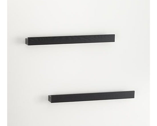 """Set of 2 Archetype 24"""" Black Photo Ledges - Smart black photo ledges with a built-in rails make it easy to display photos or artwork. Lightweight and sturdy shelves get their hidden strength from a hollow-core construction, supporting up to 36 pounds each. Combine with Archetype's other sizes for a functional, dimensional wall display."""