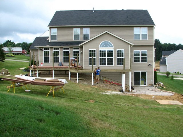 Deck with walkout basement traditional other metro for Walkout basement backyard ideas