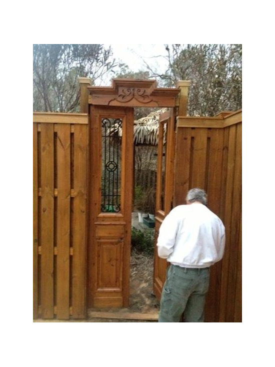 Antique French iron door used as garden gate -