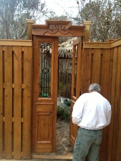 Antique French iron door used as garden gate Eclectic
