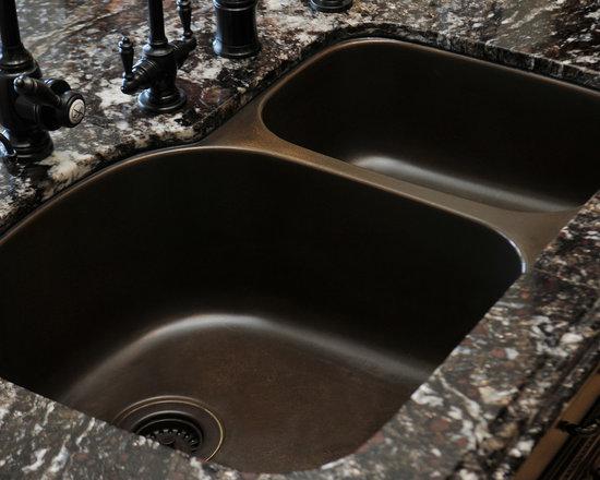 Fleur De Lis Series - Beautiful home featuring the Artisan Fleur De Lis sinks.