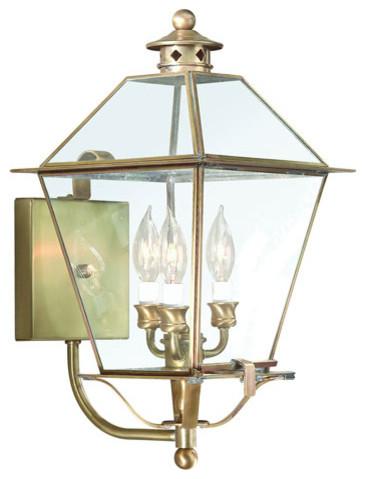 Montgomery Natural Aged Brass Three-Light Outdoor Wall Mount modern-outdoor-lighting