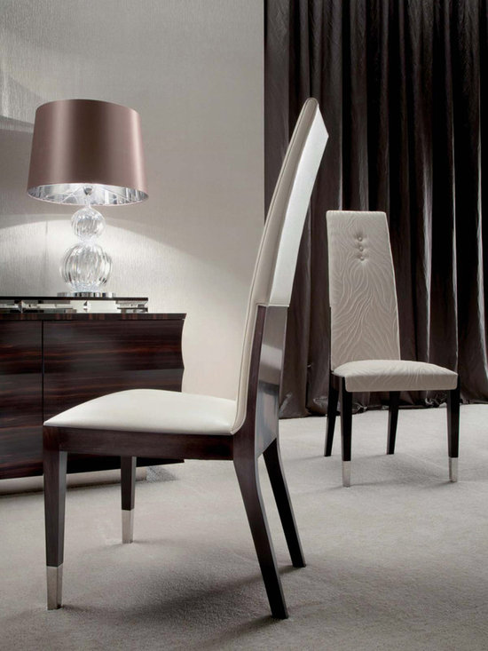 Giorgio Collection - Luxurious. Sophisticated. The Giorgio Collection's DAYDREAM dining chairs. Wrapped in deep Makassar ebony and satin finish. Beech wood base with many colors of fabric, velvet or leather. All finely crafted in Italy.