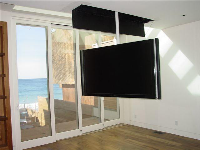 Attic mount tv lift swivel contemporary bedroom for Tv in bedroom ideas