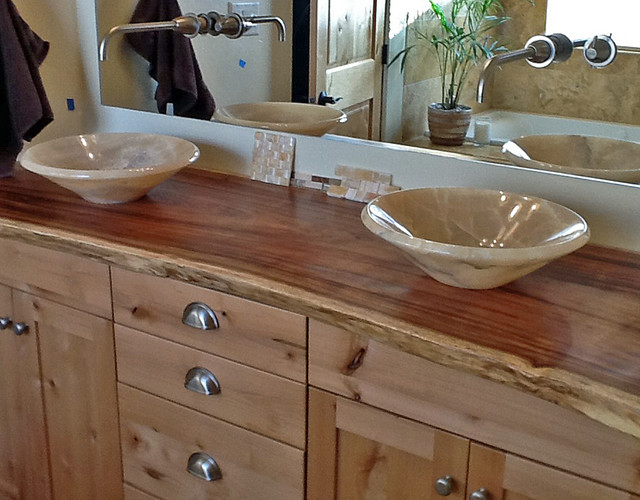 Onyx vessel sinks on natural edge wood slab vanity top for Bathroom cabinets natural wood