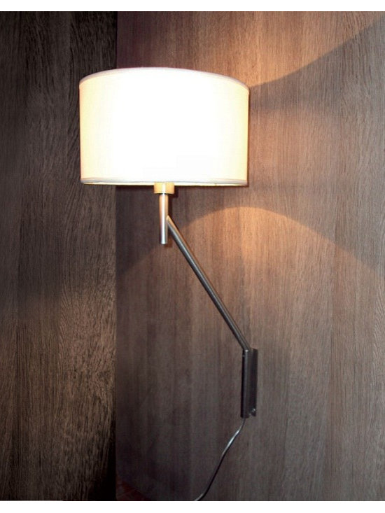 Bridget Wall Lamp by Penta Light - Bridget Wall Lamp by Penta Light. This lamp is extendable and adjustable allowing you to adjust the lamp with no restrictions for use. The lamp is available in Small (extendable and adjustable) or Large (extendable and adjustable arm). This lamp comes with a structure in satin nickel and the shade is available in a variety of fabric finishes. The metal finishing can be chrome, brass or burnished and the shape of the shade can be an oval, cylinder or trapezium.