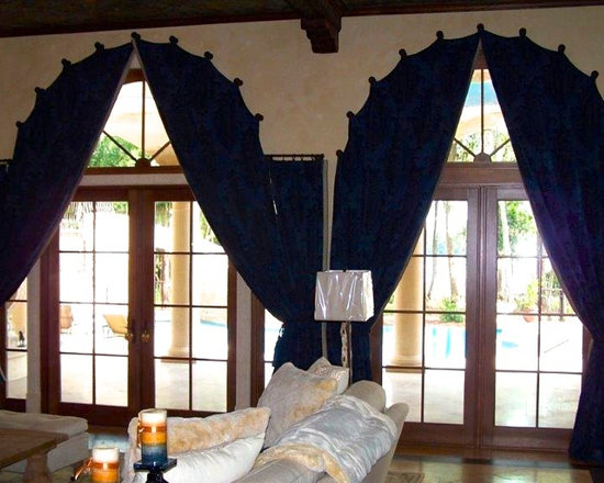 Drapery Ideas - Arched drapery panels on medallions.