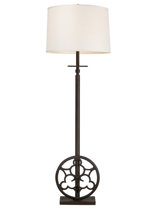 Solid Cast Iron Rustic Wheel Floor Lamp - The 18th and 19th centuries brought about a time of great engineering advancements as part of the industrial revolution. The inventions and innovations that sprung forth allowed industrial manufacturing to become more efficient that ever imagined. This floor lamp pays homage to the great machines of that time period with solid cast iron wheels, an off-white linen shade, and a Vintage Rust finish.