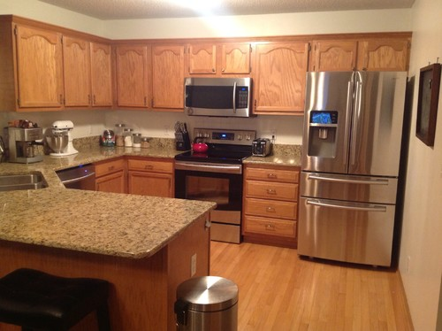Kitchen with too much oak for Kitchen paint colors with oak cabinets and stainless steel appliances