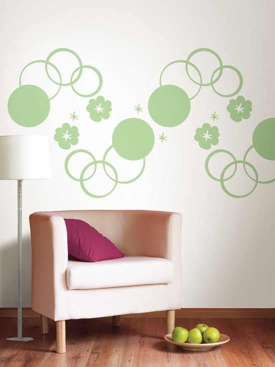 "Oh Pear Green Dots and Hooplah Set of Wall Decals - Round and round we go...fun concentric circles create very cool walls. This pack contains twelve green die-cut circles on four 13"" x 13"" sheets and eight 13"" Oh Pear Green WallPops. WallPops are repositionable and always removable."