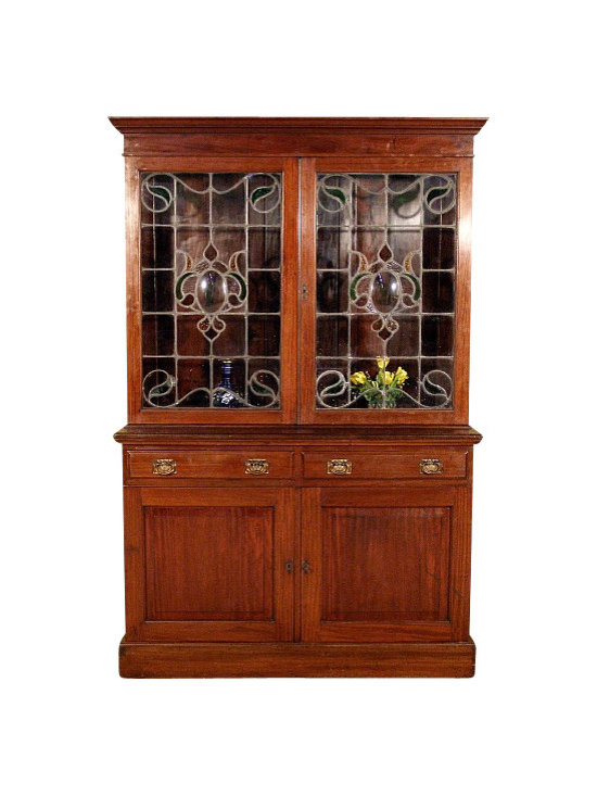 Antiques - Large Antique English Solid Mahogany Victorian Bookcase Bookshelf - This is a handsome large antique English solid Mahogany Victorian bookcase bookshelf.It has a lovely beveled cornice and it features a spacious bookshelf cabinet. The cabinet is missing its shelves but they can be easily added and the original shelf supports are included. It has two beautiful lead glazed glass doors with gorgeous decorative tainted glass designs on their center and corners. They show some age appropriate cracks and spots but considering their age, circa 1899, they are in good condition. This piece features two smooth operating drawers that are well constructed with dovetail joinery and they have very beautiful oval handles with gorgeous decorative hardware. The cabinets have four spacious shelves, two which are removable, and they have elegant paneled doors with beveled  raised surfaces. They both have lock mechanism with one key present. This bookcase has a large secret compartment on its back which can be conveniently used for hiding items behind it against the wall and since it has casters it can be easily moved. It appears that this piece used to be part of a large piece of furniture. It may have some minor age appropriate wood separations, scuffs and scratches but overall it is in good condition for its age, as is. It is a unique piece of furniture suitable with many decors.Other Dimensions (In inches)Bookcase Area 38.5H x 50W x 8.5DTop Surface 38.25H x 53W x 6.25DCabinet ShelvesTop 10.45H x 24.5W x 14DBottom 11.45H x 24.5W x 14DPlease feel free to contact us for detailed measurements of drawers.