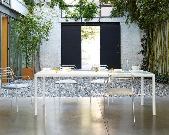 Seram - Ligne Roset - Seram in/outdoor dining table, Resille in/outdoor armchairs.
