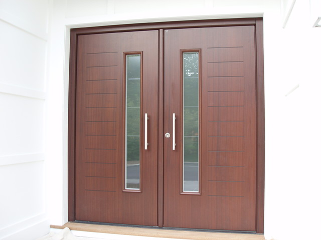 Custom designed double front door in mahagony finish for Modern front double door designs
