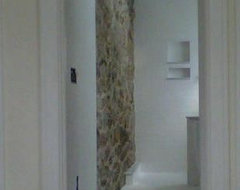 Exposed stone Master bedroom Addition traditional bathroom
