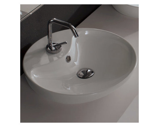 "Scarabeo - Sleek Shallow Round Ceramic Vessel Bathroom Sink - This sleek and shallow white ceramic bathroom sink is designed and manufactured in Italy by Scarabeo. Contemporary circular above counter vessel sink includes overflow and a single faucet hole. Sink dimensions: 17.70"" (width), 4.70"" (height), 17.70"" (depth)"
