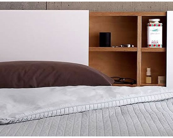 MASHstudios Headboard - This no frills bed Headboard is designed low to the ground and with a bare minimum of components. The wall-mounted Headboard by MASHstudios has a sliding aluminum panel that doubles as a storage space to keep bedside miscellany out of sight.