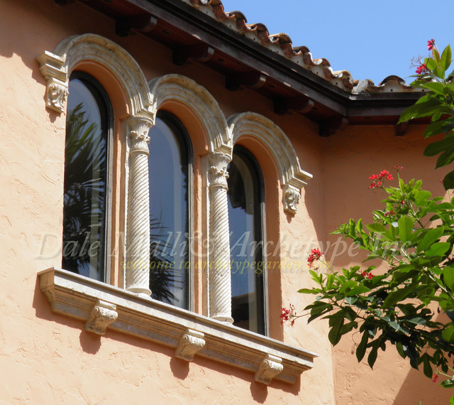 Arched window moldings columns sills mediterranean for How to decorate an arched window