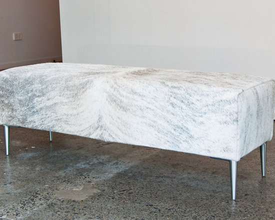 Gorgeous Creatures New Zealand - Light grey cowhide bench ottoman for end of bed - A long rectangle light exotic grey cowhide ottoman 120cm x 30cm x 40cm tall with simple straight aluminium legs.