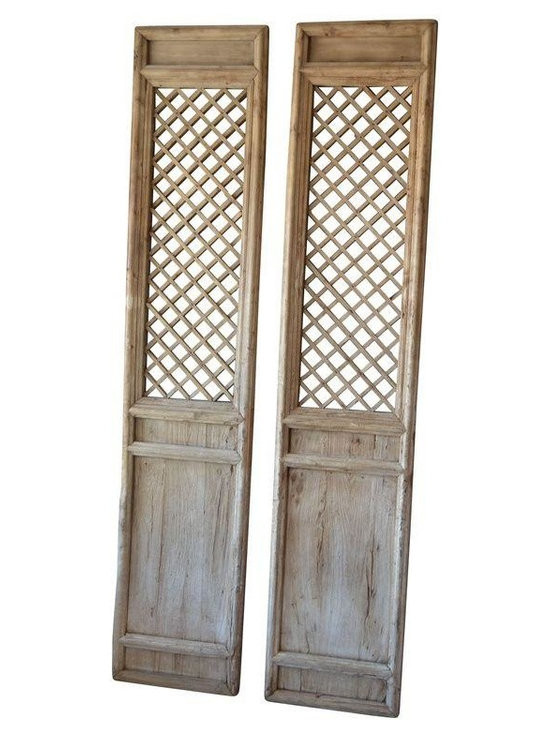 Pre-owned Antique Chinese Screens - A Pair - A pair of antique Chinese screens with a texture and patina that only time can bring. The pale weathered wood brings a natural component to a space, while the size adds architectural interest and scale. With a latticed upper portion and a solid lower section, they can replace current interior doors, lean against the wall as art, or take the place of a traditional headboard.     Measurements for each screen may vary slightly due to its handmade nature. The wood was intentionally left in a more natural state, so knicks, knots, and splits are present, but do not affect the structural integrity of the piece. Due to the age of the piece, there are some minor areas of shifted lattice sections (see photo representations), but they also do not affect the structural integrity.     There are two pairs of screens are available; please contact support@chairish.com if you are interested in purchasing more than one pair.