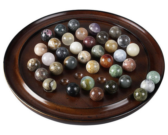 """Inviting Home - Semi-Precious Stones Solitaire - semi-precious stones solitaire game 9-3/4"""" x 1-3/8""""H *38 hand-made marbles At least 15 different semi-precious minerals. Malachite Azurite Quartz Serpentine Hematite Bloodstone Lazulite Amethyst Crystal Garnet... Try your hand at jewel-like stones with our precious solitaire� All the marbles for this solitaire game are mined hand-cut ground and polished by hand in Madagascar. Madagascar is known for its unique variety of minerals. Every mineral is by definition unique giving every Solitaire marble set its own unique character. Configuration depends on season and availability. Your game may contain marbles of the same mineral but of different colors. Depending on the mining season during the time of production this game may include marbles formed of the following minerals: Agate Mousse Amazonite Amphibole Anhydride Apatite (blue green) Aragonite Calcite (blue orange yellow other) Chalcocite Cipolin Colombite Cormaline Crystal Feldspath GalenaGirasol Gneiss Hematoide (red) Jasper (green red yellow other) Labradorite Marble (rose white) Microcline Opal Quartz Rhodonite Septarian Serpentine Sphene Spinel. The game of Solitaire is reputed to have been invented by a nobleman confined in the Bastille prison during the early years of the French Revolution. Solitaire game is played with 36 marbles. The object is to eliminate all but one marble which should ideally end up in the center of the game board. Contents: A collection of 38 (two spares) hand-cut and polished semi-precious marbles selected for color and variety. Game board made of non-endangered hardwood. To play: Fill all the indents with marbles then remove the center marble and place on the outer ring (fig.). The player begins by selecting a marble that can jump over another marble in either horizontal or vertical directions and land in an empty space. Then the jumped marble is removed and placed on the outer ring. Continue jumping and removing marbles until no furth"""