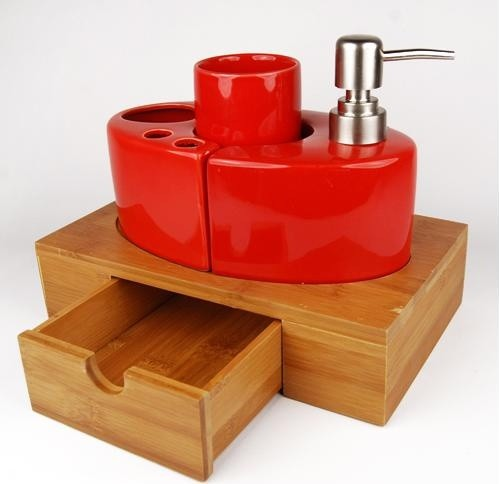 red ceramic bath accessory set with bamboo caddy