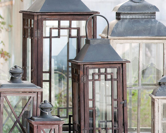 Estate Lantern (Set of Two) - Outdoor friendly wood and metal lighting. You receive one medium and one large version of the open chimney lanterns… We recommend the use of flameless candles for maximum safety and party-through-the-night illumination.