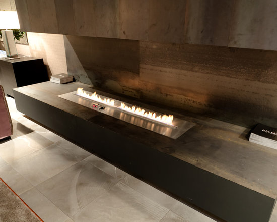 Planika: Fire Line Automatic - Fire Line Automatic , the latest bioethanol fireplace by Planika, is designed primarily for architects and interior designers. The versatile, linear burner can be wall-mounted , recessed into a shelf or used as a see-through or free-standing fireplace.