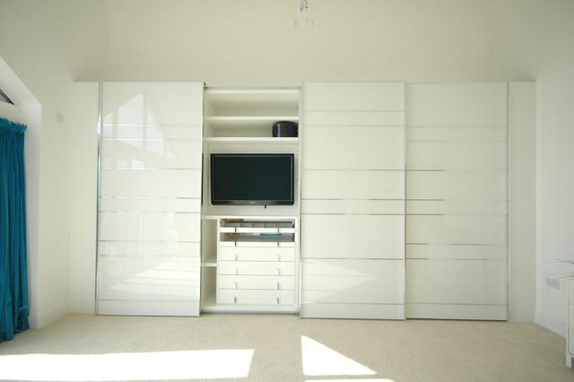 Stylish sliding door wardrobe in contemporary new build. - Contemporary - Closet - south west ...