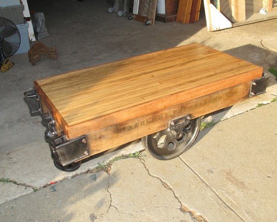 Examples of available inventory - bryan appleton,coffee table from antique factory cart, polished and laquered wheels and hardware, top is vintage repurposed bowling alley stock. Several avail.